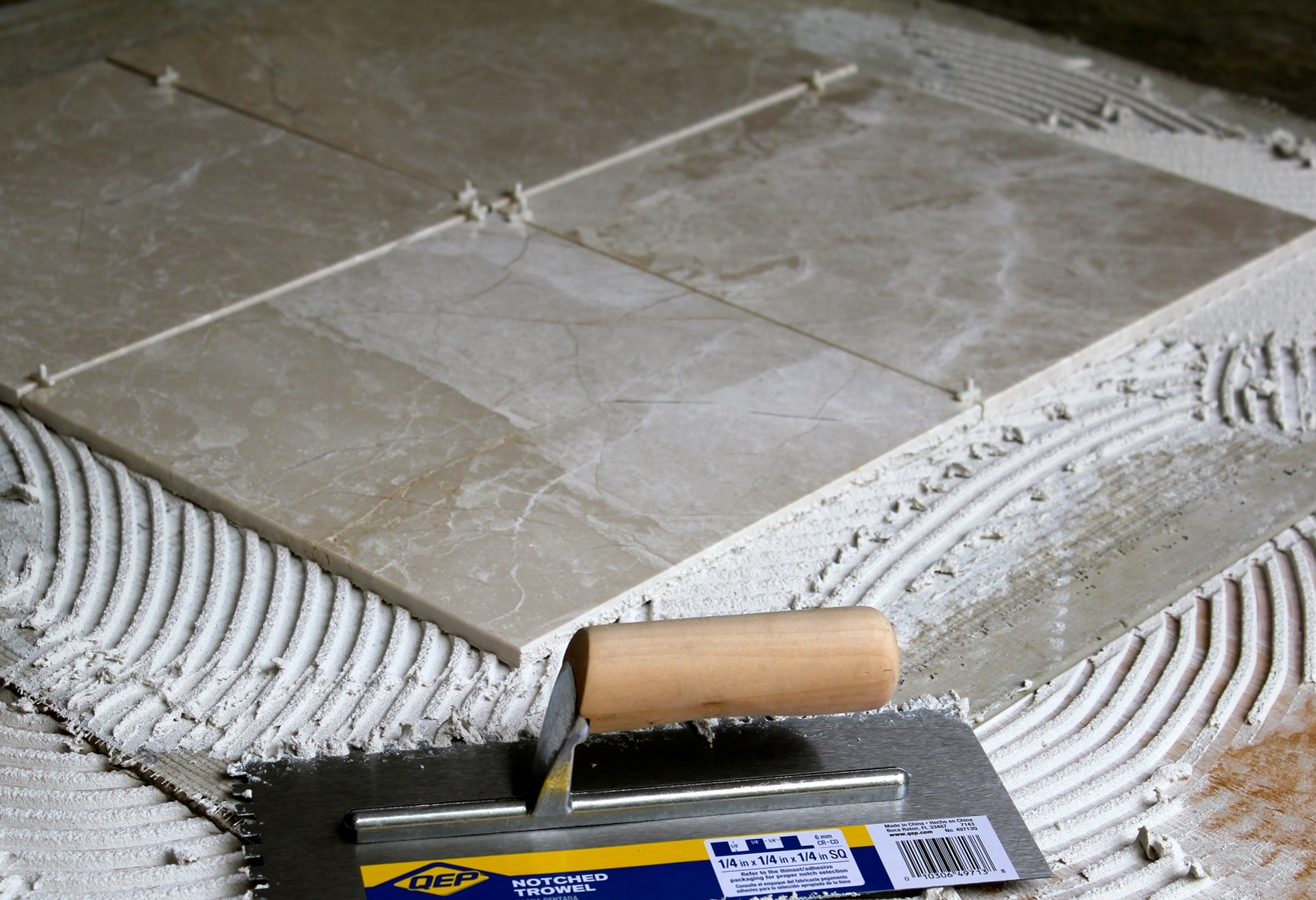 Installing marble tile pro construction guide spreading thinset and laying tiles dailygadgetfo Images