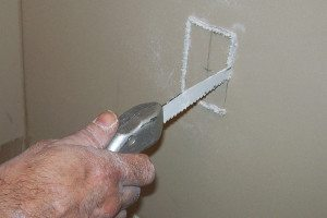 2- Using a jab saw, cut out and remove the drywall