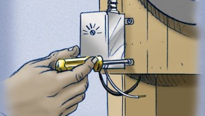 Attach the fan's thermostat to a nearby joist