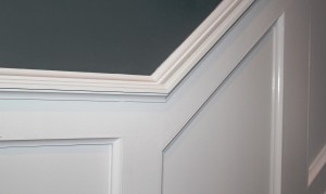 Attach the chair rail stock to the wall on top of the top rail
