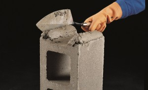 Press the block into the mortar bed
