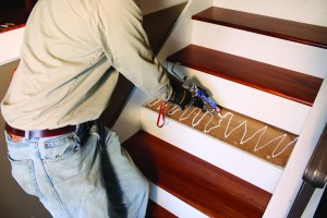 Install treads using construction adhesive and finish nails.