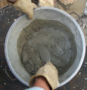Mix your mortar in a metal bucket or shallow pan