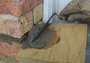 Rake the mortar and push it into the joint with the trowel.
