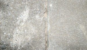 Concrete spalling is concrete that has had the top protective layer removed