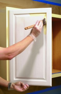 For raised-panel doors, begin painting the corners and profiles first.