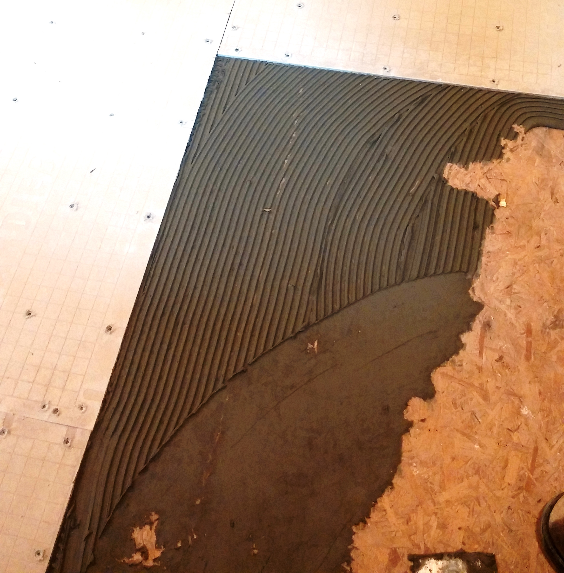 How to install underlayment for tile proconstruction guide use the notched edge to comb out the thinset dailygadgetfo Gallery